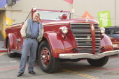 Host Jay Leno drives away in one of his many 'automobiles' a vintage collector red fire engine after the show on April 16 2007