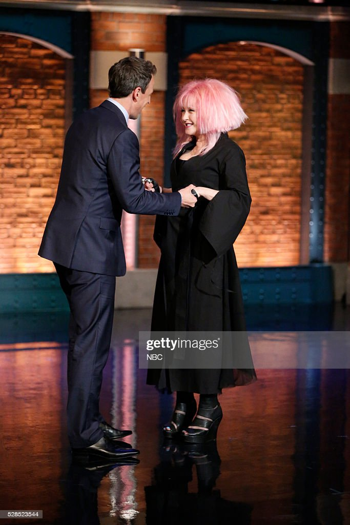 Host <a gi-track='captionPersonalityLinkClicked' href=/galleries/search?phrase=Seth+Meyers&family=editorial&specificpeople=618859 ng-click='$event.stopPropagation()'>Seth Meyers</a> greets musical guest <a gi-track='captionPersonalityLinkClicked' href=/galleries/search?phrase=Cyndi+Lauper&family=editorial&specificpeople=171290 ng-click='$event.stopPropagation()'>Cyndi Lauper</a> on May 5, 2016 --