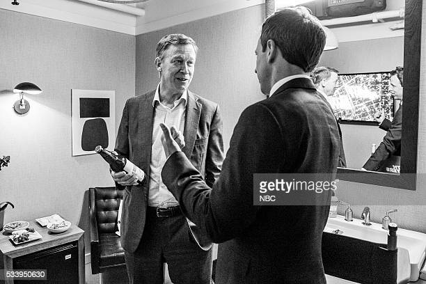 MEYERS Episode 374 Pictured Governor John Hickenlooper talks with host Seth Meyers backstage on May 23 2016