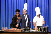 Actress Leslie Jones and host Seth Meyers during a cooking demonstration with chef Carlo Mirarchi on July 21 2016