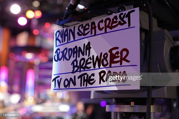 LENO Episode 4044 Pictured Ryan Seacrest Jordana Brewster TV On The Radio cue card on May 17 2011 Photo by Stacie McChesney/NBC/NBCU Photo Bank