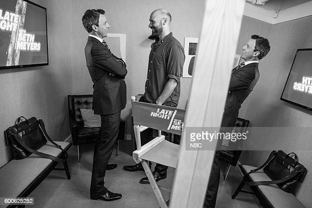 Host Seth Meyers talks with actor Corey Stoll backstage on September 7 2016