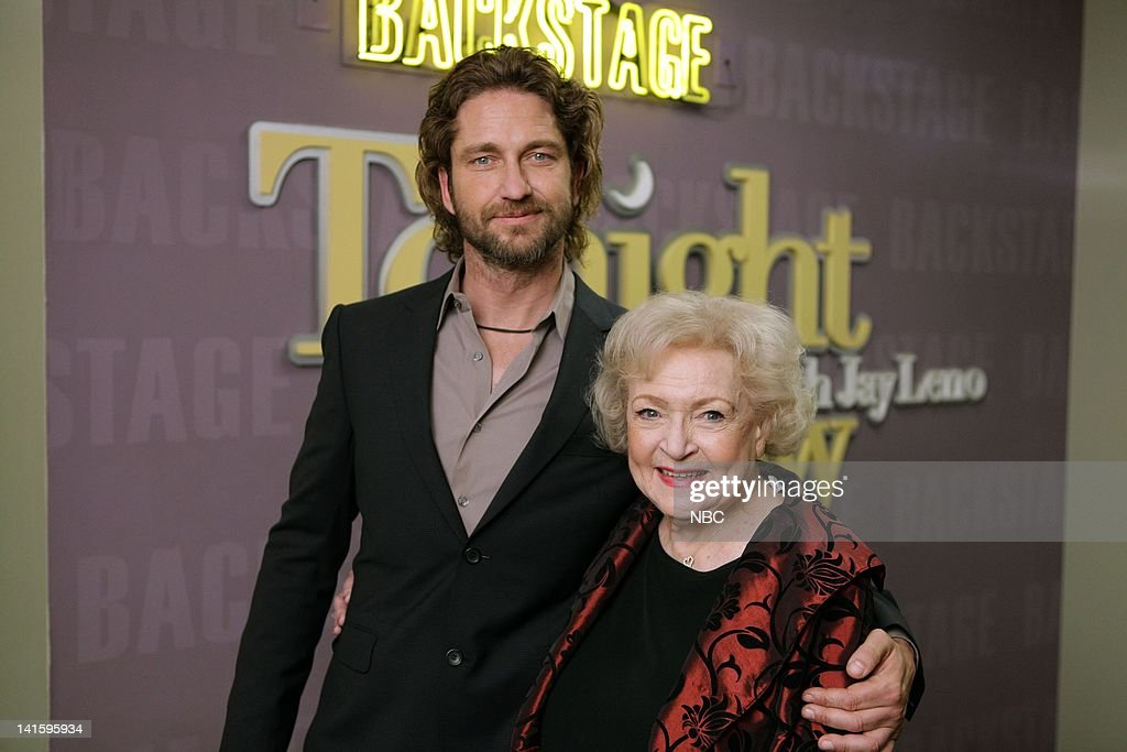 LENO -- (EXCLUSIVE COVERAGE) Episode 4181 -- Pictured: (l-r) Actor Gerard Butler with actress Betty White backstage on January 12, 2012 -- Photo by: Paul Drinkwater/NBC/NBCU Photo Bank