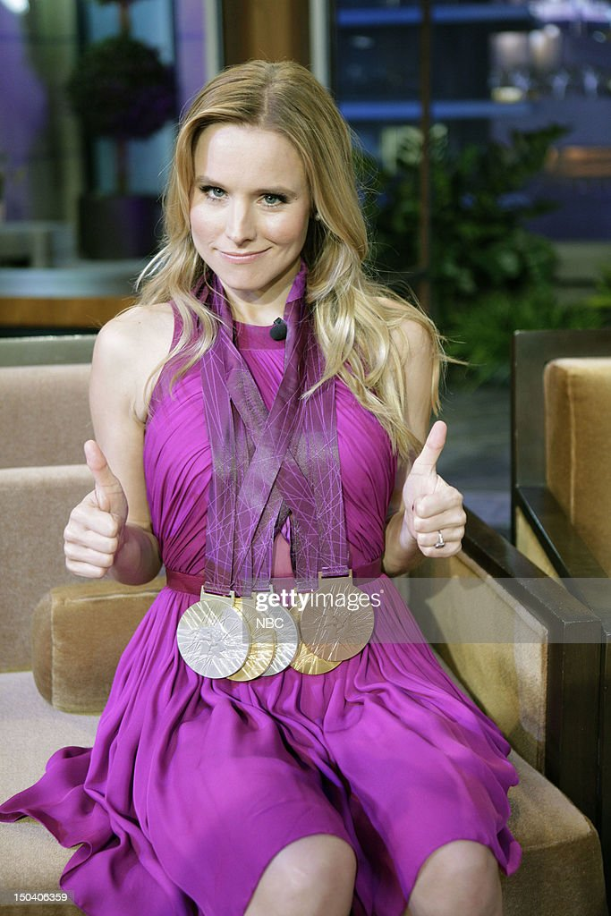 LENO -- (EXCLUSIVE COVERAGE) -- Episode 4300 -- Pictured: Actress Kristen Bell wears Ryan Lochte's Olympic medals during a commercial break on August 16, 2012 --