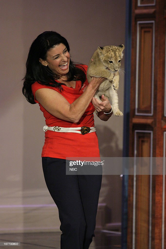 Animal Expert Julia Scardina arrives with a baby lion on December 5, 2012 --
