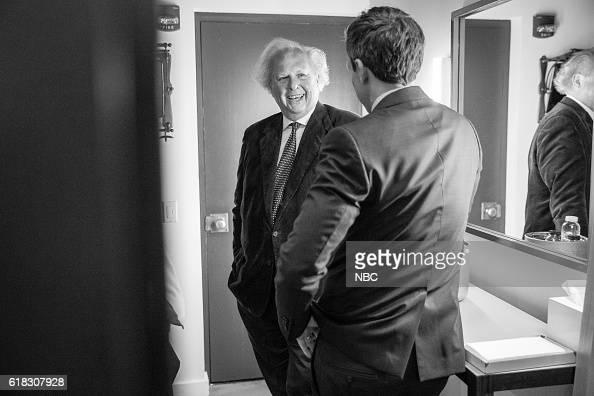 MEYERS Episode 438 Pictured Vanity Fair editor Graydon Carter talks with host Seth Meyers backstage on October 25 2016