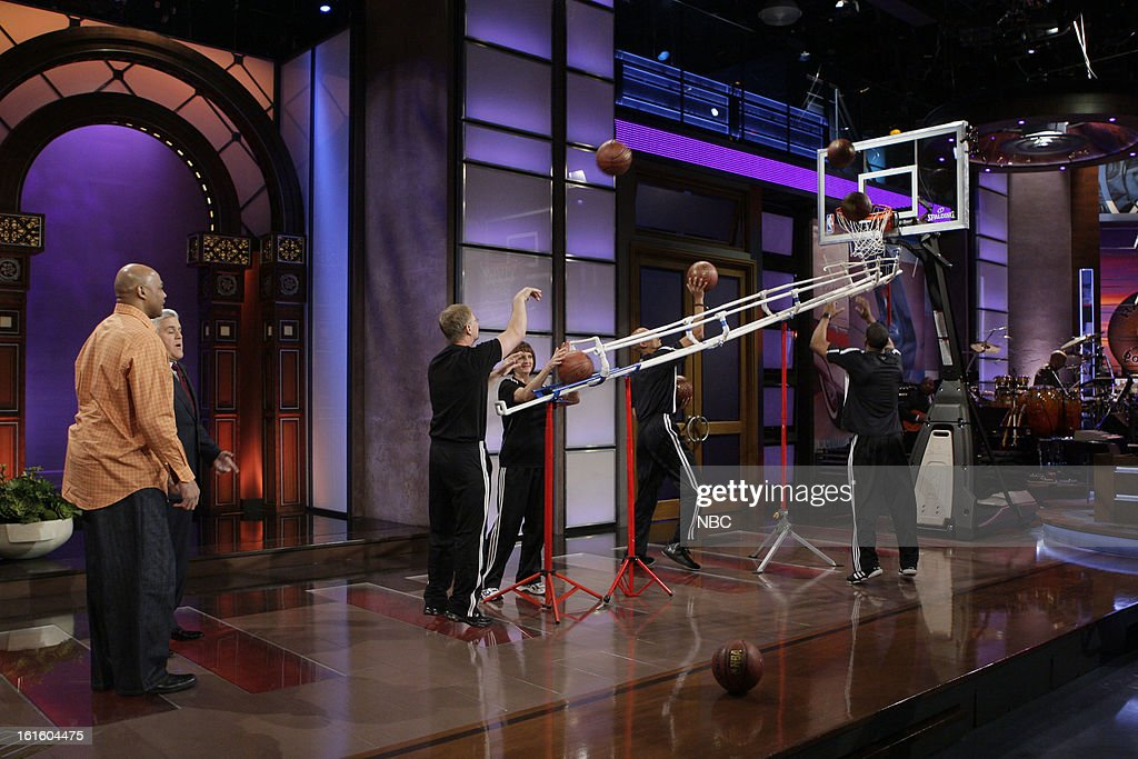 Former basketball player Charles Barkley and host Jay Leno watch Bob Fischer, The World's Fastest Free Throw Shooter shoot free throws on February 12, 2013 --