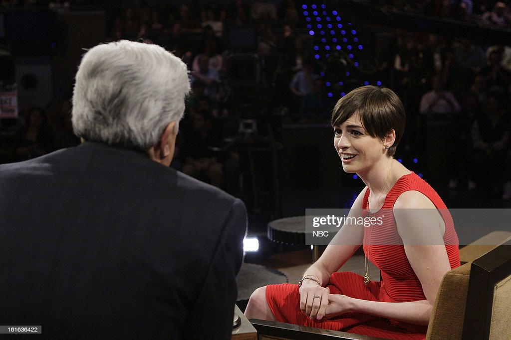 LENO -- (EXCLUSIVE COVERAGE) -- Episode 4408 -- Pictured: (l-r) Host Jay Leno talks with actress <a gi-track='captionPersonalityLinkClicked' href=/galleries/search?phrase=Anne+Hathaway+-+Actress&family=editorial&specificpeople=11647173 ng-click='$event.stopPropagation()'>Anne Hathaway</a> during a commercial break on February 13, 2013 --