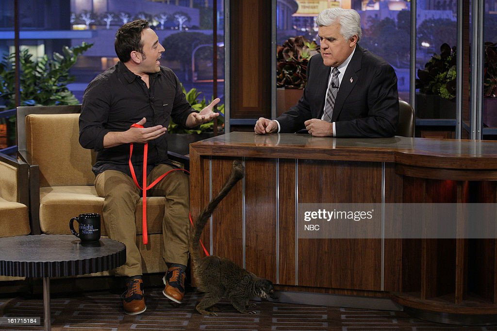 Animal expert Jarod Miller with a baby lemur during an interview with host <a gi-track='captionPersonalityLinkClicked' href=/galleries/search?phrase=Jay+Leno+-+Television+Host&family=editorial&specificpeople=156431 ng-click='$event.stopPropagation()'>Jay Leno</a> on February 14, 2013 --