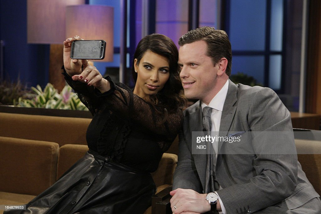 LENO -- (EXCLUSIVE COVERAGE) -- Episode 4434 -- Pictured: (l-r) <a gi-track='captionPersonalityLinkClicked' href=/galleries/search?phrase=Kim+Kardashian&family=editorial&specificpeople=753387 ng-click='$event.stopPropagation()'>Kim Kardashian</a> and <a gi-track='captionPersonalityLinkClicked' href=/galleries/search?phrase=Willie+Geist&family=editorial&specificpeople=1284469 ng-click='$event.stopPropagation()'>Willie Geist</a> take a selfie on their iPhone on March 28, 2013 --