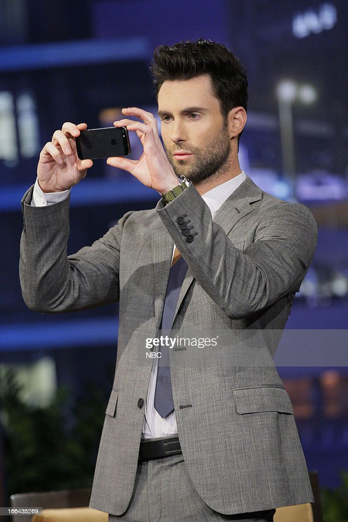 LENO -- (EXCLUSIVE COVERAGE) -- Episode 4444 -- Pictured: <a gi-track='captionPersonalityLinkClicked' href=/galleries/search?phrase=Adam+Levine+-+Singer&family=editorial&specificpeople=202962 ng-click='$event.stopPropagation()'>Adam Levine</a> takes a picture of the audience during a commercial break on April 12, 2013 --