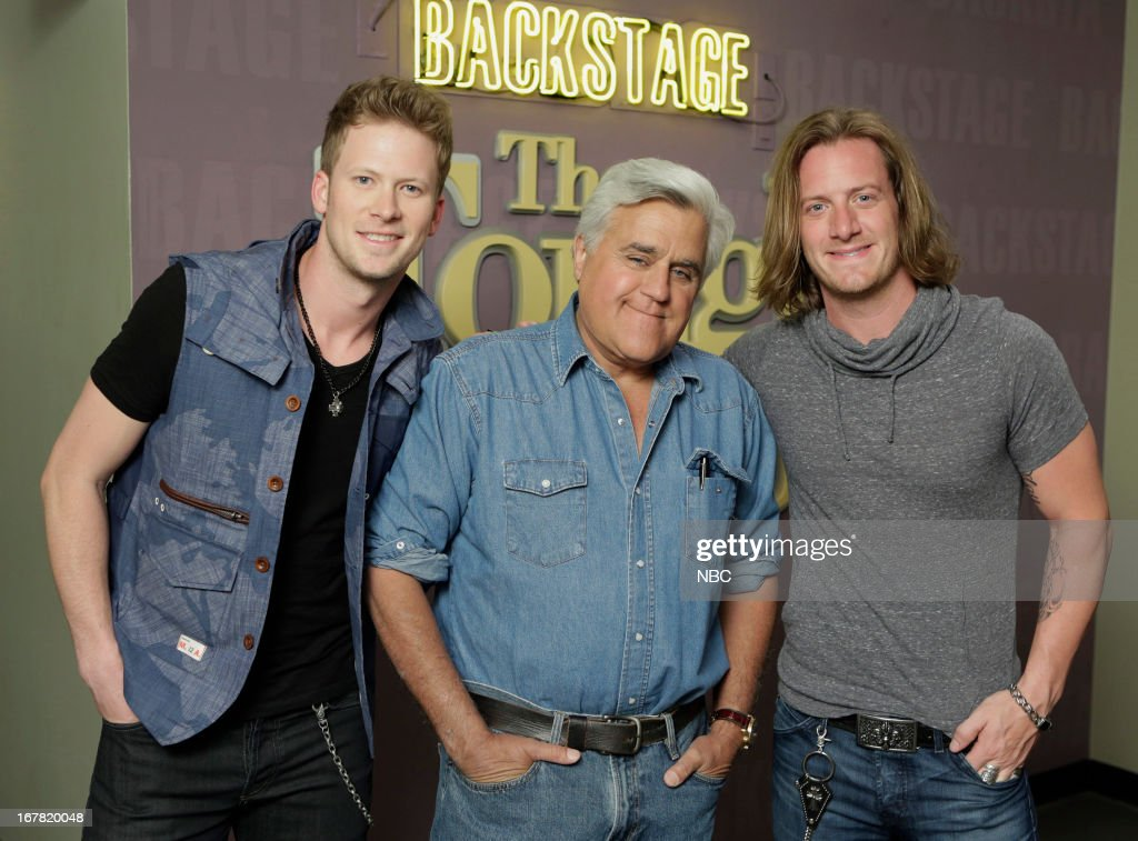LENO -- (EXCLUSIVE COVERAGE) Episode 4451 -- Pictured: (l-r) Brian Kelley, host Jay Leno, <a gi-track='captionPersonalityLinkClicked' href=/galleries/search?phrase=Tyler+Hubbard&family=editorial&specificpeople=9453787 ng-click='$event.stopPropagation()'>Tyler Hubbard</a> of musical guests Florida Georgia Line on April 30, 2013 --