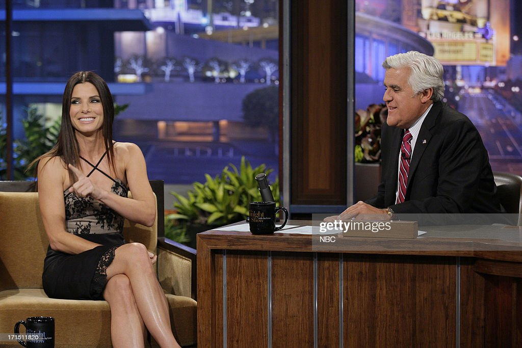 Actress <a gi-track='captionPersonalityLinkClicked' href=/galleries/search?phrase=Sandra+Bullock&family=editorial&specificpeople=202248 ng-click='$event.stopPropagation()'>Sandra Bullock</a> during an interview with host Jay Leno on June 25, 2013 --