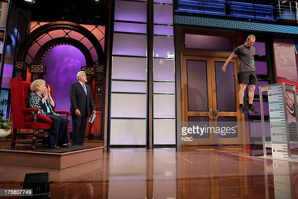 Actress Betty White and host Jay Leno watch as Kevin Bania attempts a 55in vertical leap during the 'Does this Delight Betty White' skit on August 8...