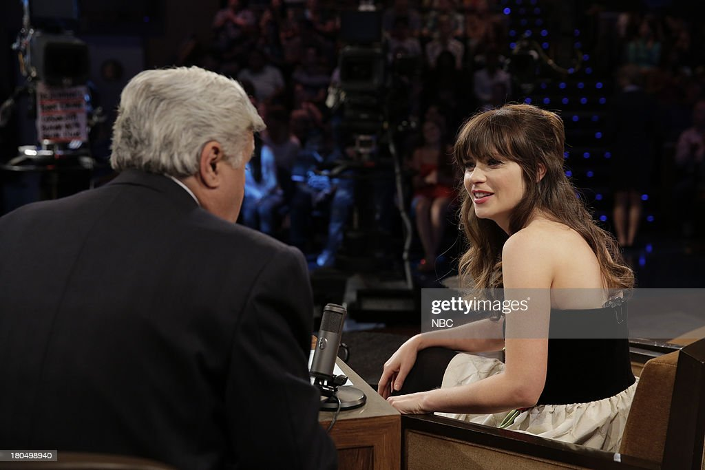 LENO -- (EXCLUSIVE COVERAGE) Episode 4528 -- Pictured: (l-r) Host Jay Leno talks with Actress <a gi-track='captionPersonalityLinkClicked' href=/galleries/search?phrase=Zooey+Deschanel&family=editorial&specificpeople=202927 ng-click='$event.stopPropagation()'>Zooey Deschanel</a> during a commercial break on September 13, 2013 --
