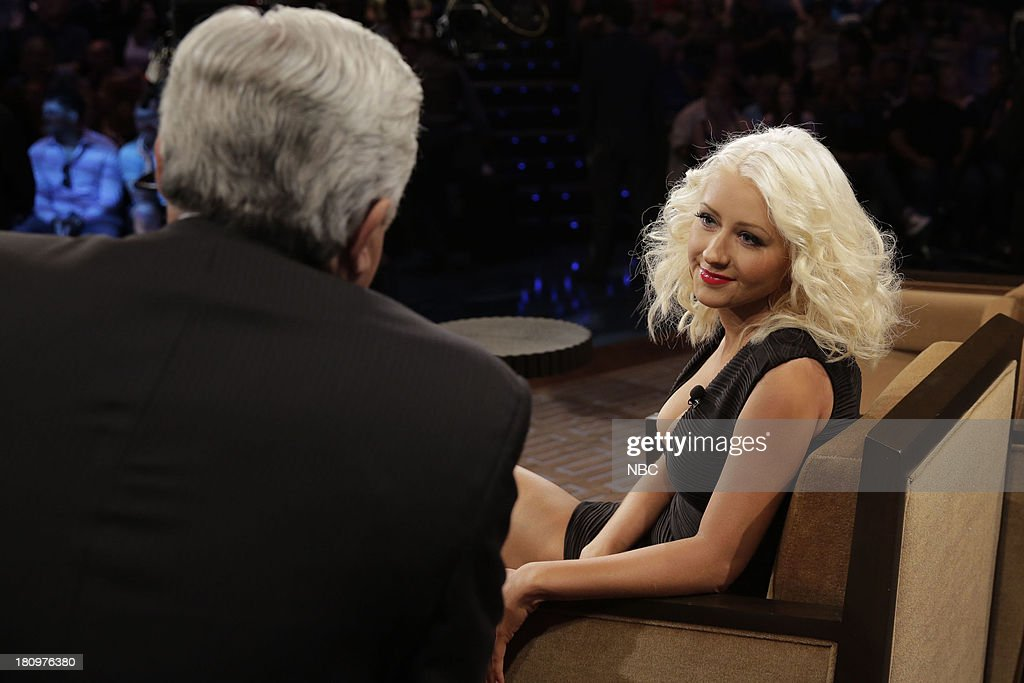 LENO -- Episode 4531 -- (EXCLUSIVE COVERAGE) -- Pictured: (l-r) Host Jay Leno talkws with singer <a gi-track='captionPersonalityLinkClicked' href=/galleries/search?phrase=Christina+Aguilera&family=editorial&specificpeople=171272 ng-click='$event.stopPropagation()'>Christina Aguilera</a> during a commerical break on September 18, 2013 --