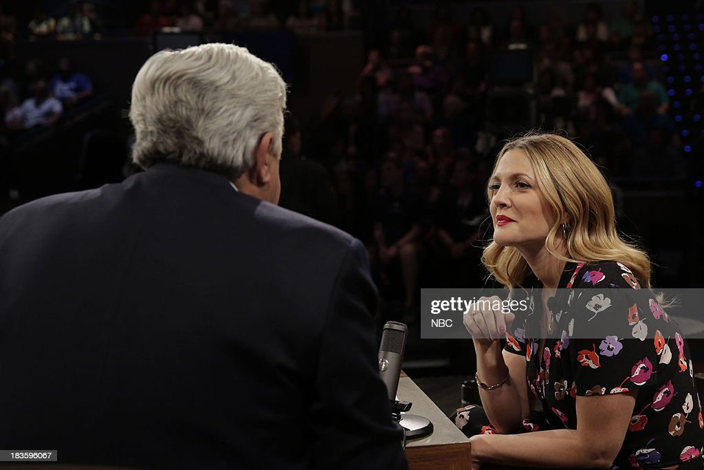 LENO -- Episode 4544 -- (EXCLUSIVE COVERAGE) -- Pictured: (l-r) Host Jay Leno talks with actress Drew Barrymore during a commercial break on October 7, 2013 --