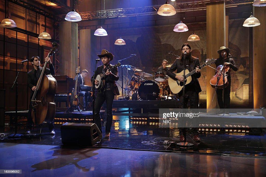Paul DeFiglia, Bob Crawford, Scott Avett, Mike Marsh, Seth Avett of musical guest The Avett Brothers perform on October 7, 2013 --