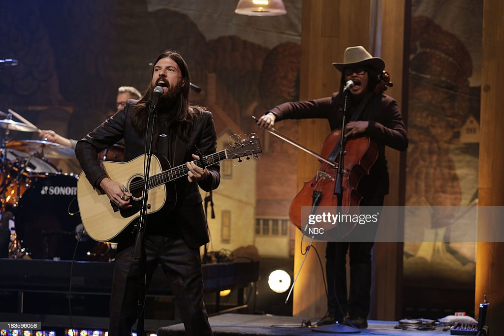 <a gi-track='captionPersonalityLinkClicked' href=/galleries/search?phrase=Seth+Avett&family=editorial&specificpeople=4271007 ng-click='$event.stopPropagation()'>Seth Avett</a> of musical guest The Avett Brothers performs on October 7, 2013 --