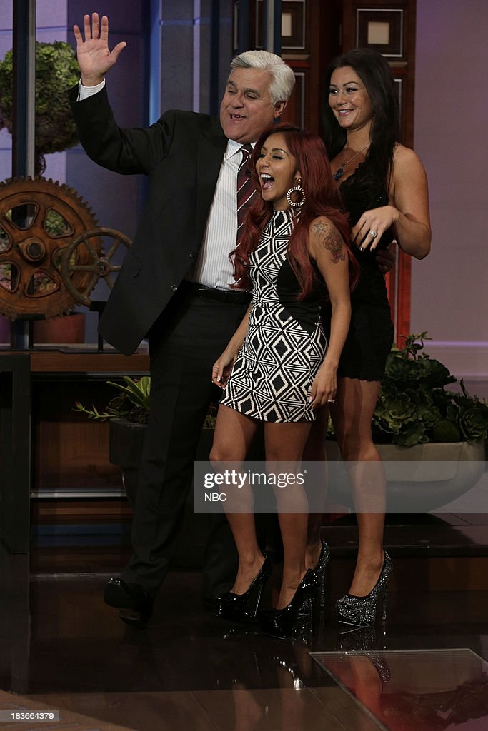 Host Jay Leno greets Nicole 'Snooki' Polizzi and Jennifer 'JWoww' Farley on October 8, 2013 --