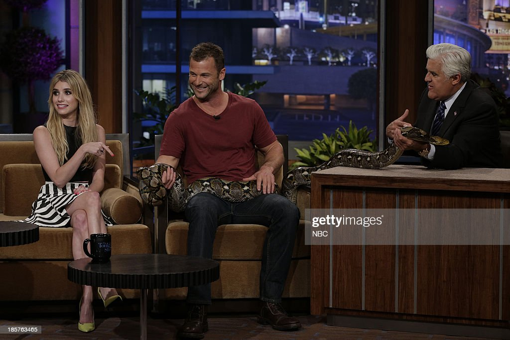 Actress Emma Roberts, animal expert Dave Salmoni and host Jay Leno handle a boa constrictor on October 24, 2013 --