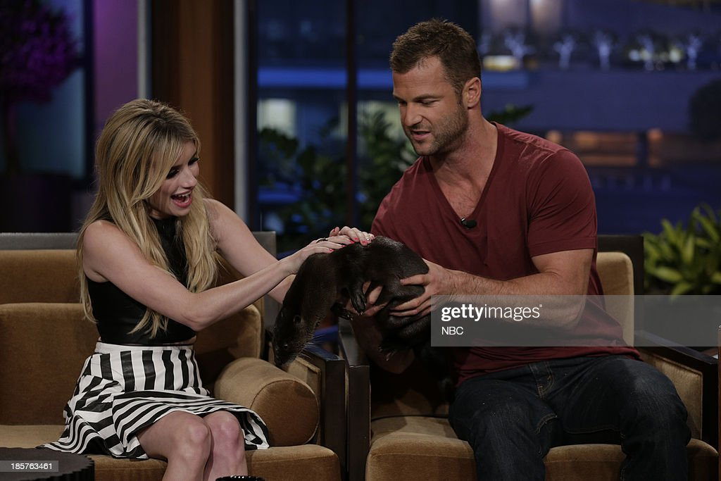 Actress Emma Roberts pets a North American river otter with animal expert Dave Salmoni during an interview on October 24, 2013 --