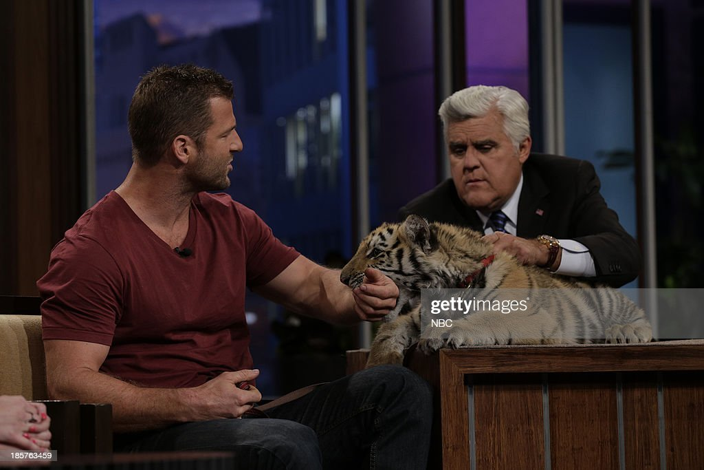 Animal expert Dave Salmoni with a bengal tiger during an interview with host Jay Leno on October 24, 2013 --