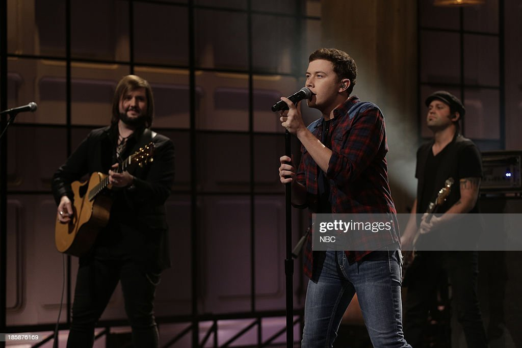Musical guest <a gi-track='captionPersonalityLinkClicked' href=/galleries/search?phrase=Scotty+McCreery&family=editorial&specificpeople=7520936 ng-click='$event.stopPropagation()'>Scotty McCreery</a> performs on October 25, 2013 --