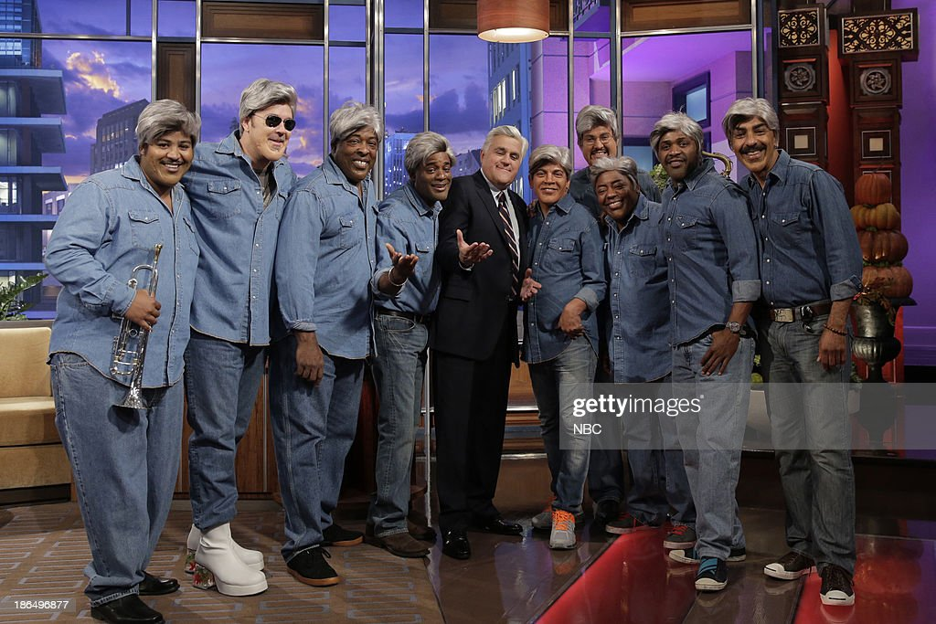 LENO -- Episode 4557 -- (EXCLUSIVE COVERAGE) -- Pictured: (l-r) Raymond Monteiro, David Delhomme, Wayne Linsey, Dorian Holley, host Jay Leno, Rickey Minor, Miguel Gandelman, Paul Jackson Jr., Randolph Ellis, Kevin Ricard on October 31, 2013 --
