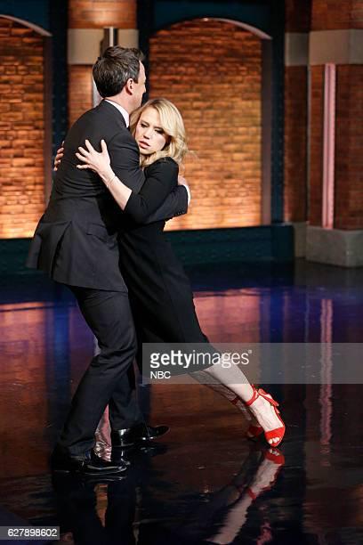Host Seth Meyers greets comedian Kate McKinnon on December 5 2016