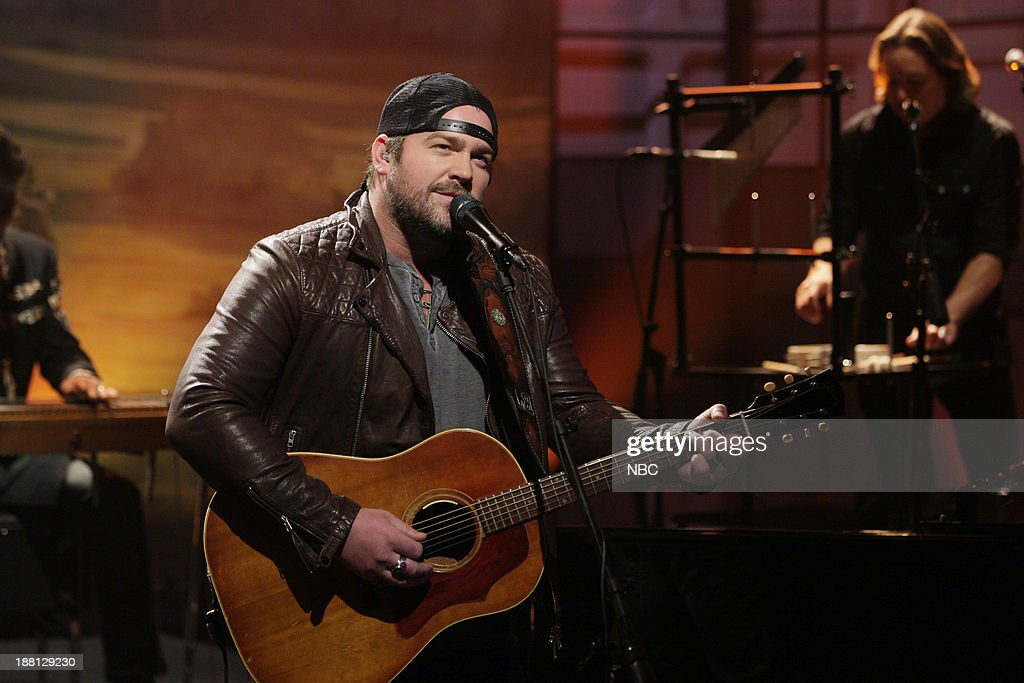 Musical guest <a gi-track='captionPersonalityLinkClicked' href=/galleries/search?phrase=Lee+Brice&family=editorial&specificpeople=4290648 ng-click='$event.stopPropagation()'>Lee Brice</a> performs on November 18, 2013 --