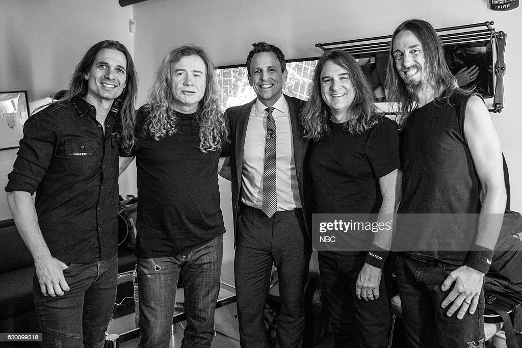MEYERS -- (EXCLUSIVE COVERAGE) -- Episode 463 -- Pictured: (l-r) Kiko Loureiro, Dave Mustaine, David Ellefson and Dirk Verbeuren of musical guest Megadeth with host Seth Meyers (center) backstage on December 15, 2016 --