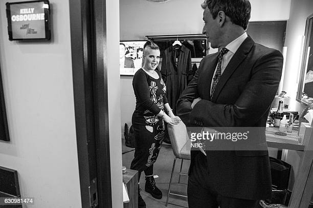 MEYERS Episode 466 Pictured TV Personality Kelly Osbourne talks with host Seth Meyers backstage on December 21 2016