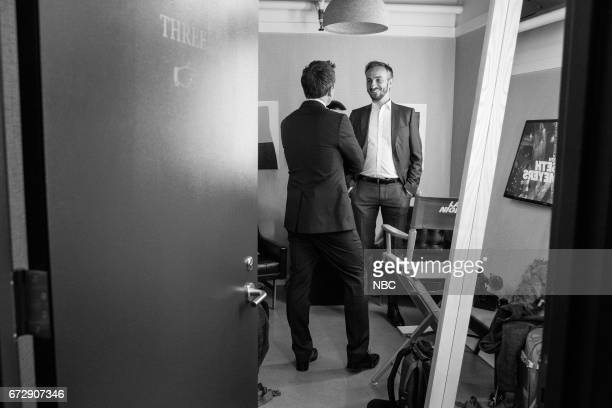 MEYERS Episode 516 Pictured Host Seth Meyers talks with talk show host Jan Böhmermann backstage on April 24 2017