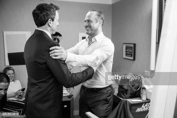 MEYERS Episode 524 Pictured Host Seth Meyers talks with actor Chris Meloni backstage on May 8 2017
