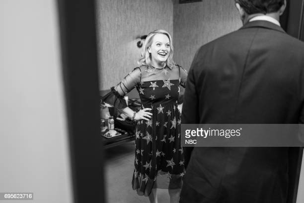 MEYERS Episode 540 Pictured Actress Elisabeth Moss talks with host Seth Meyers backstage on June 12 2017