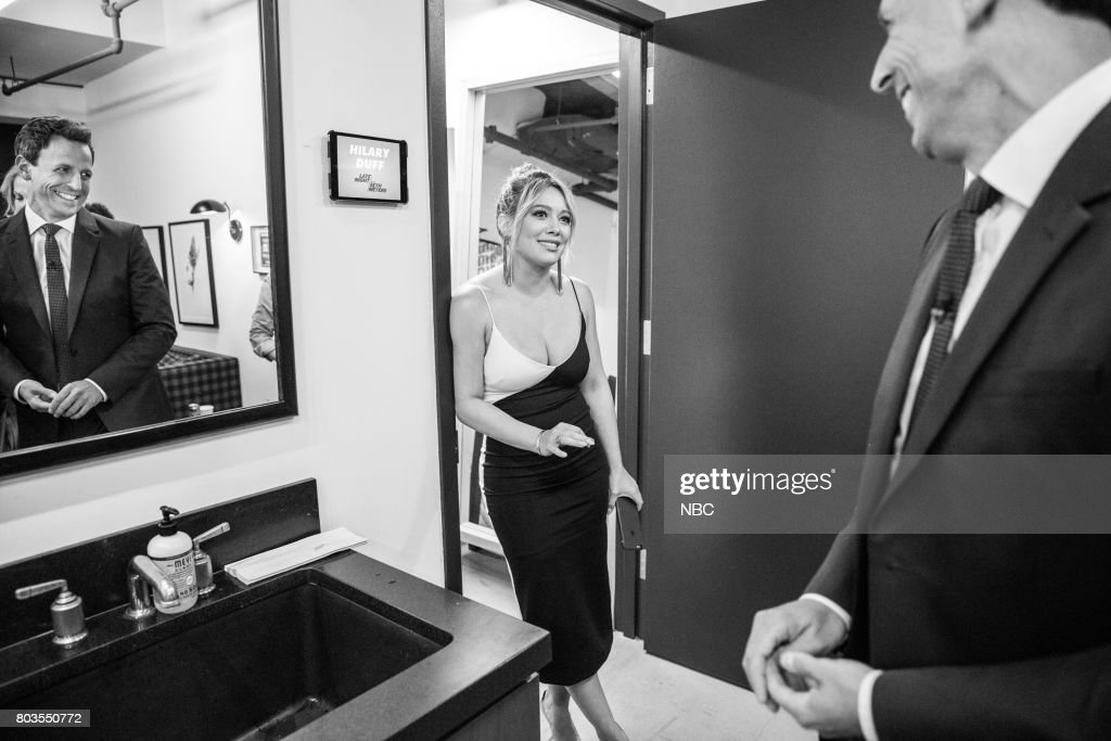 MEYERS -- (EXCLUSIVE COVERAGE) -- Episode 550 -- Pictured: (l-r) Actress/singer Hilary Duff talks with host Seth Meyers backstage on June 28, 2017 --