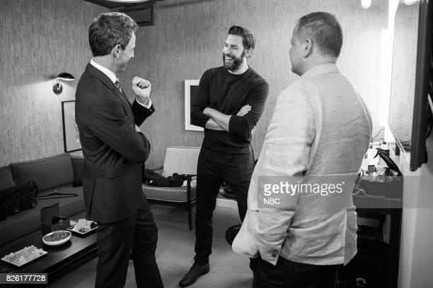 MEYERS Episode 563 Pictured Host Seth Meyers talks with actor John Krasinski backstage on August 3 2017