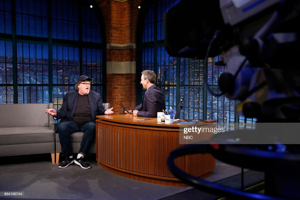 Filmmaker Michael Moore talks with host Seth Meyers during an interview on August 17, 2017 --