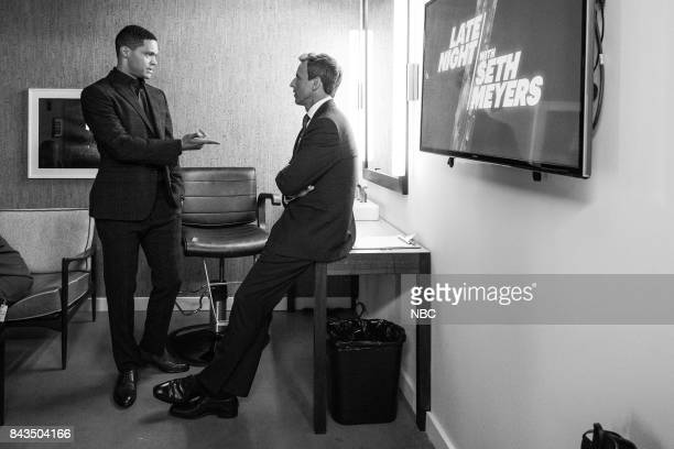 """MEYERS Episode 573 Pictured Host of """"The Daily Show"""" Trevor Noah talks with host Seth Meyers backstage on September 6 2017"""