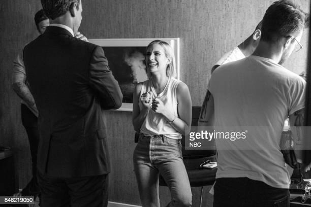 Host Seth Meyers talks with actress Emma Roberts backstage on September 12 2017