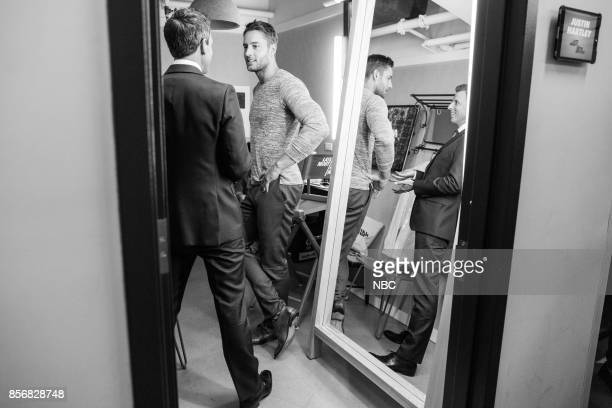 MEYERS Episode 587 Pictured Host Seth Meyers talks with actor Justin Hartley backstage on October 2 2017