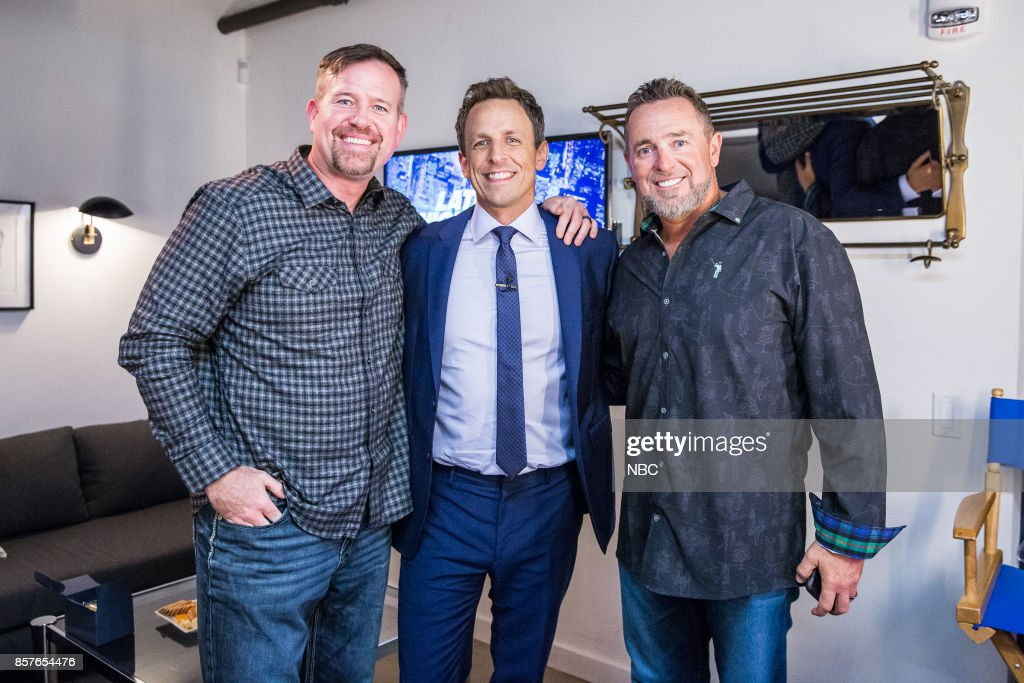 MEYERS -- (EXCLUSIVE COVERAGE) -- Episode 589 -- Pictured: (l-r) MLB Network's, Sean Casey and Kevin Millar with host Seth Meyers (center) backstage on October 4, 2017 --