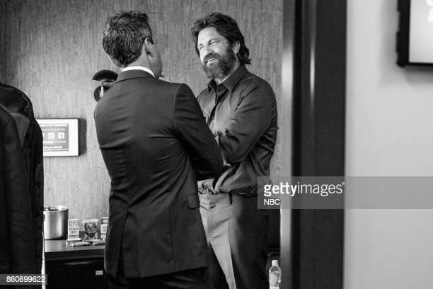 MEYERS Episode 594 Pictured Host Seth Meyers talks with actor Gerard Butler backstage on October 12 2017