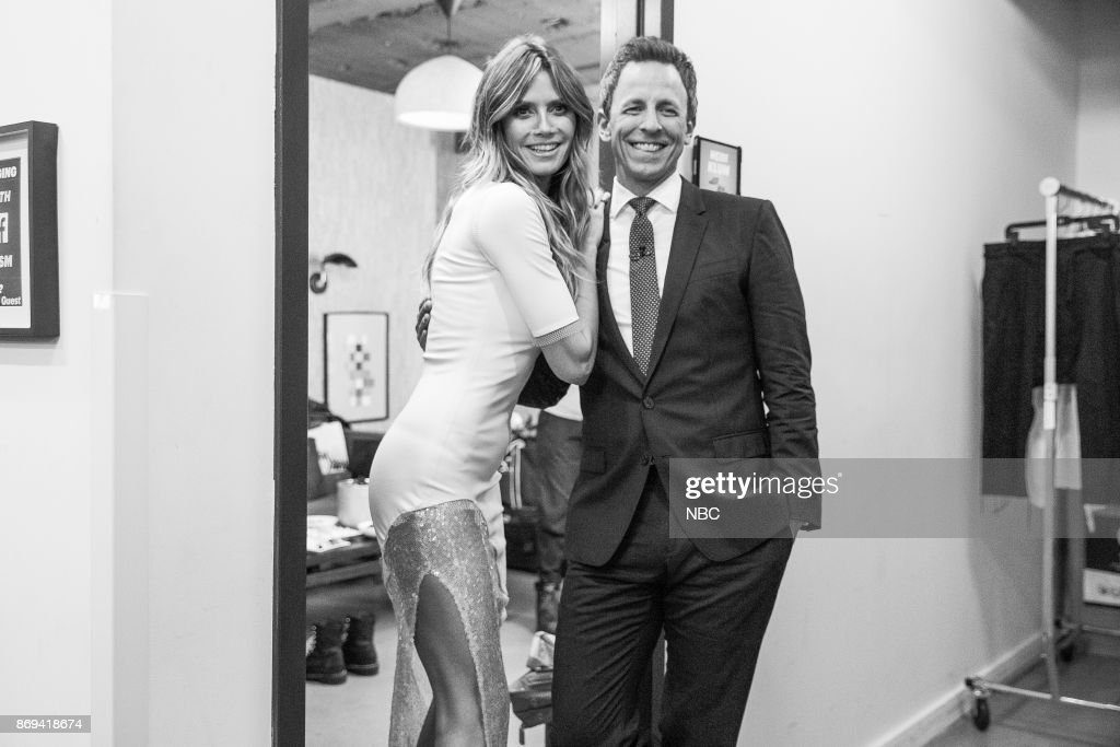 MEYERS -- (EXCLUSIVE COVERAGE) Episode 599 -- Pictured: (l-r) Model Heidi Klum talks with host Seth Meyers on October 30, 2017 --