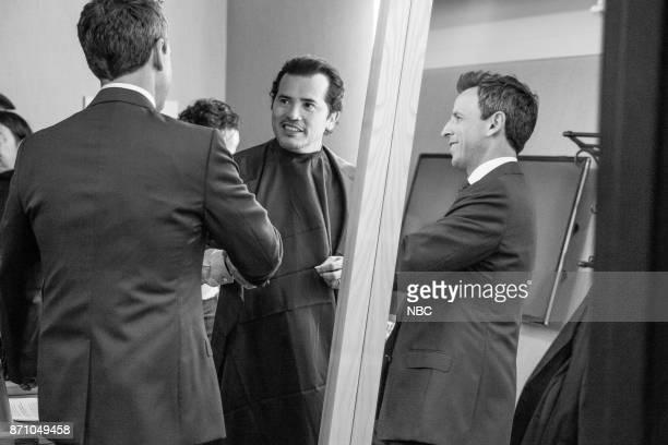 MEYERS Episode 603 Pictured Host Seth Meyers talks with actor John Leguizamo backstage on November 3 2017