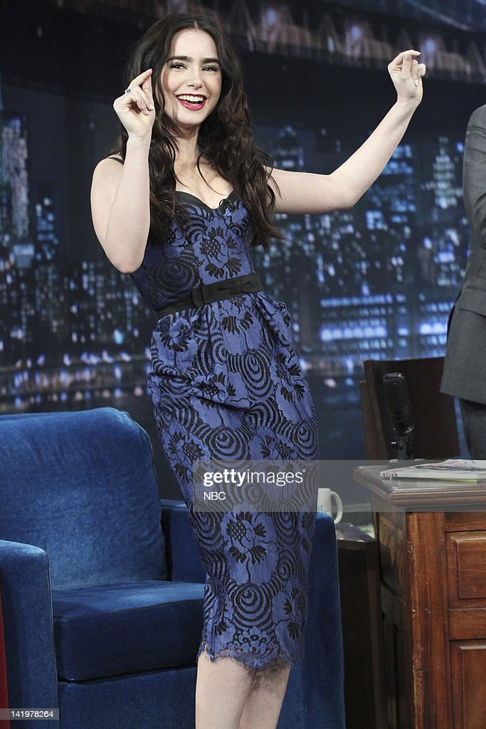 <a gi-track='captionPersonalityLinkClicked' href=/galleries/search?phrase=Lily+Collins&family=editorial&specificpeople=3520243 ng-click='$event.stopPropagation()'>Lily Collins</a> --