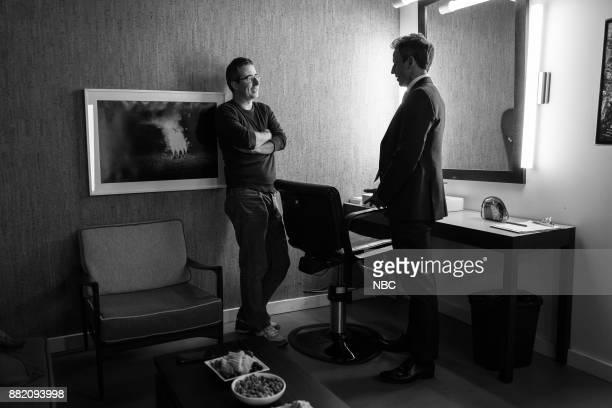 MEYERS Episode 617 Pictured Comedian John Oliver talks with host Seth Meyers backstage on November 29 2017