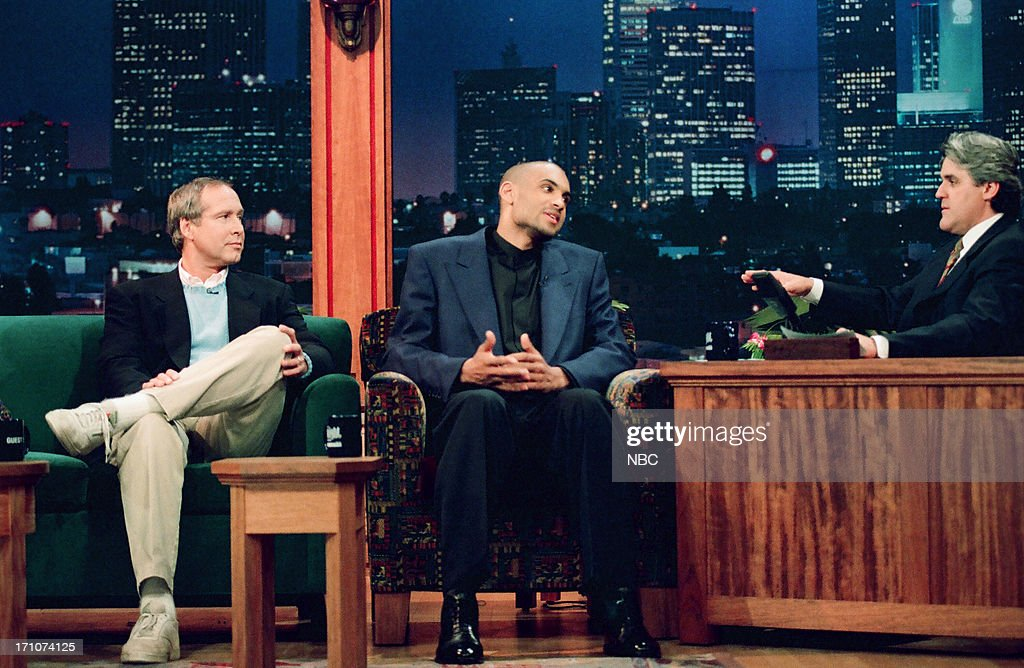 Actor Chevy Chase and basketball player <a gi-track='captionPersonalityLinkClicked' href=/galleries/search?phrase=Grant+Hill+-+Basketball+Player&family=editorial&specificpeople=201658 ng-click='$event.stopPropagation()'>Grant Hill</a> during an interview with host Jay Leno on March 16, 1995 --
