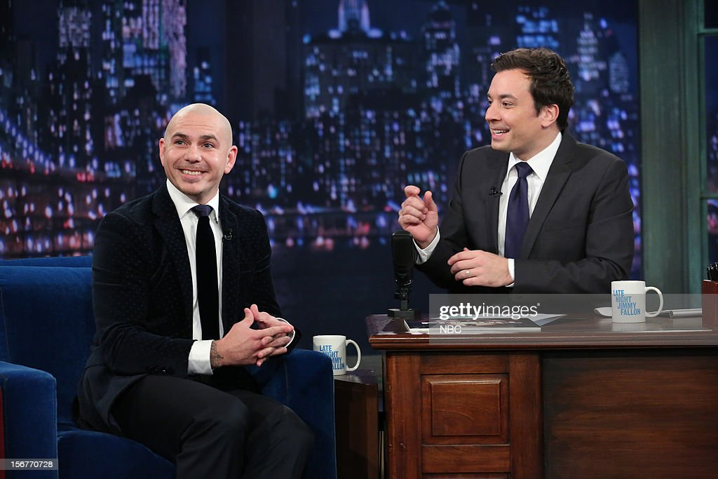 Pitbull during an interview with host <a gi-track='captionPersonalityLinkClicked' href=/galleries/search?phrase=Jimmy+Fallon&family=editorial&specificpeople=171520 ng-click='$event.stopPropagation()'>Jimmy Fallon</a> on November 20, 2012 --